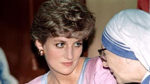 Diana listens to a senior nun of the Missionaries of Charity at the house of Mother Teresa in Calcutta on 15 February, 1992
